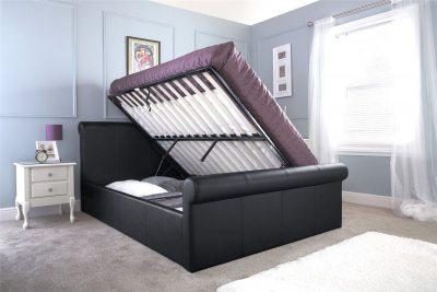 Miegamojo lova su patalynes dėže pasikeliančia iš šono